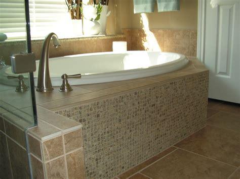 master bath with granite mosaic tub skirt to match granite