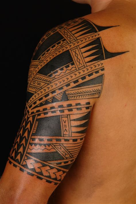 Amazing Shane Tattoo Style on upper arm - | TattooMagz