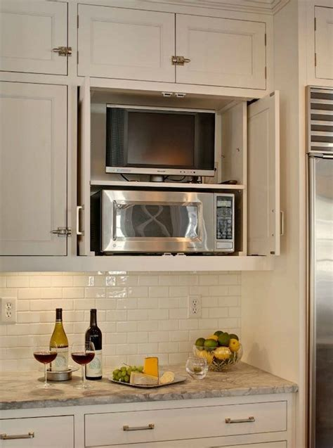 tv for kitchen cabinet clever way to hide the tv microwave in the kitchen 8598