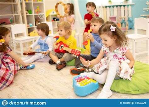 But it's an important lesson to learn that the more effort you put into something, the better the result will be. Children Learning Musical Instruments On Lesson In Kindergarten Stock Photo - Image of ...
