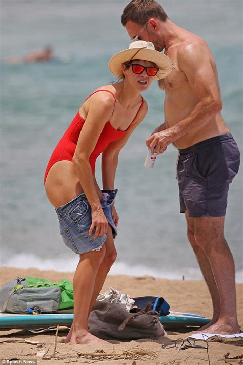 jonahhill swimsuit michelle monaghan shows off her tanned and toned figure in