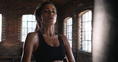 lauren young gym beautiful kickboxing woman training punching bag in