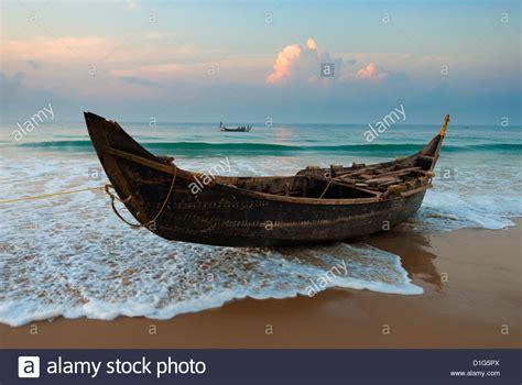 Kerala Fishing Boat Picture traditional fishing boat on tide line chowara beach near