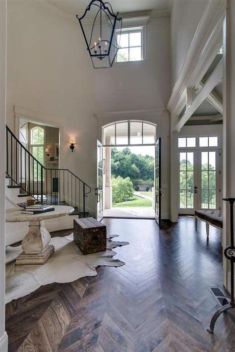 story foyer  wood herringbone floors cottage