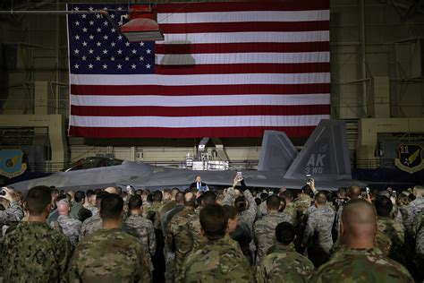alaska base military trump anchorage president troops front elmendorf stands air force arctic eye reuters speaks fighter donald jet while