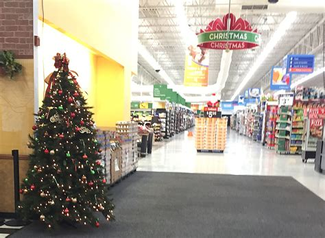 update walmart replaces christmas trees at entrances
