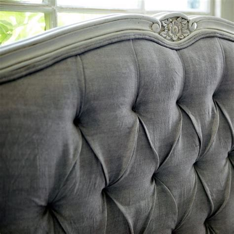 grey tufted headboard  detailed carved trim lovely