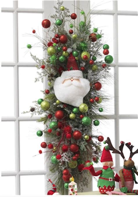 christmas window decoration swag with santa and ornaments