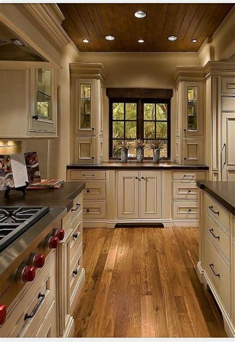 elegant  homey kitchen  vanilla bean colored cabinets mixed  warm wood tones