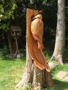 chainsaw carved dragons giant woodpecker  images
