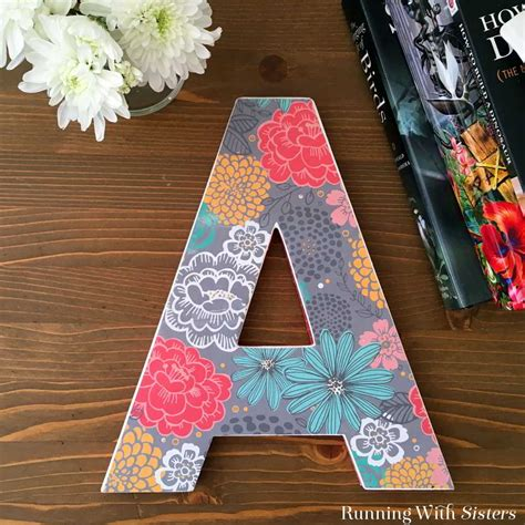 mod podge pictures on wood letters decorate a wooden letter using mod podge running with 12886