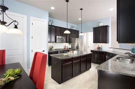 light brown kitchen gehan homes kitchen light blue walls accents 3732