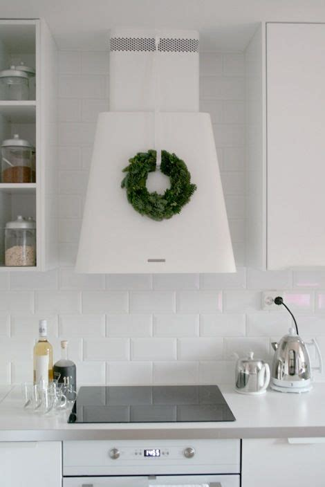 range hood christmas decorating ideas and pretty way to decorate your kitchen add a wreath to the fan simple decor