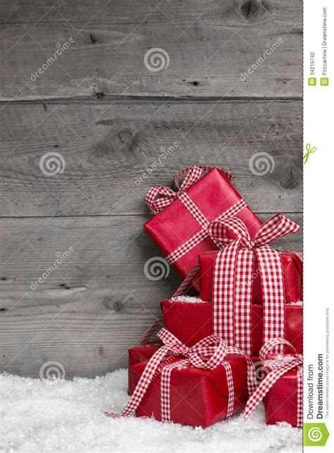 pile  red christmas gifts snow  grey wooden
