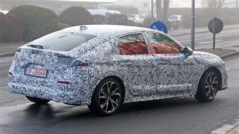 Seeing the hatchback in person confirmed what our earlier spy shots showed: 2022 Honda Civic Hatchback spy photos | Autoblog
