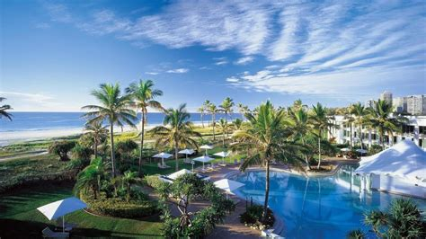 Hotel clouds palm trees spa swimming pools Wallpaper (42112)