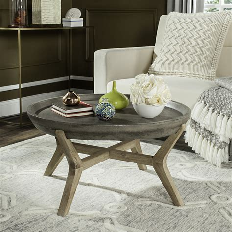 Browse a variety of modern furniture, housewares and decor. Safavieh Wynn Outdoor Modern Round Coffee Table - Dark Grey/Distressed - Walmart.com - Walmart.com