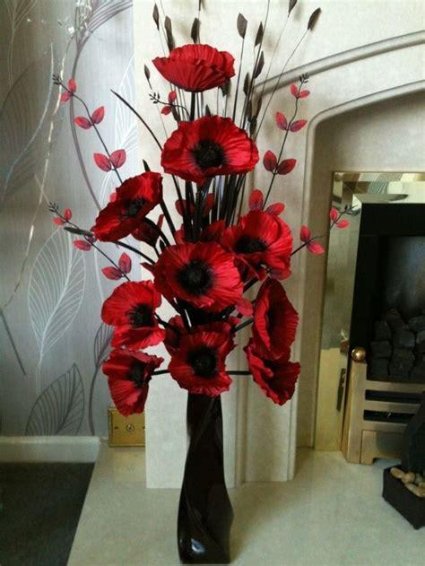 artificial silk flower arrangement  red poppies  black