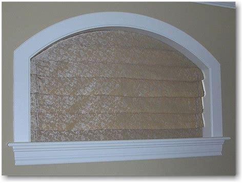 operating roman shade   arch top window