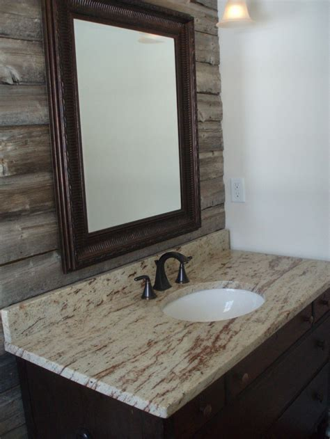 powder room  barn wood accent wall granite counter