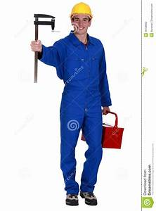 Worker Holding Measuring Device Stock Photo