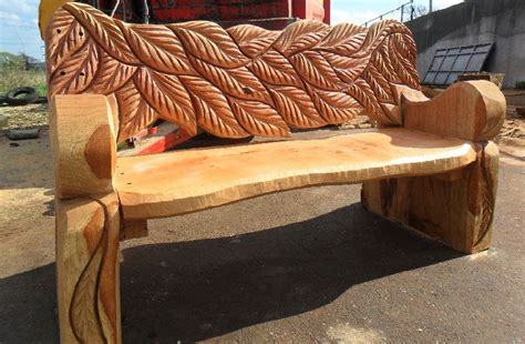 chainsaw carved wood benches  andy oneill wildwoodcarvingcouk web site design