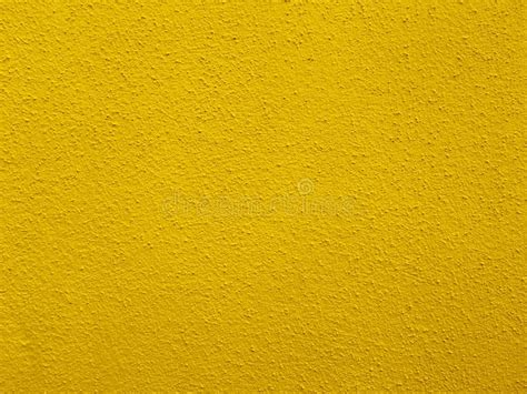 concrete wall in bright yellow color image