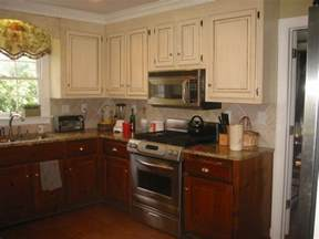 two color kitchen cabinet ideas sheshe the home magician to paint or not to paint those wood cabinets