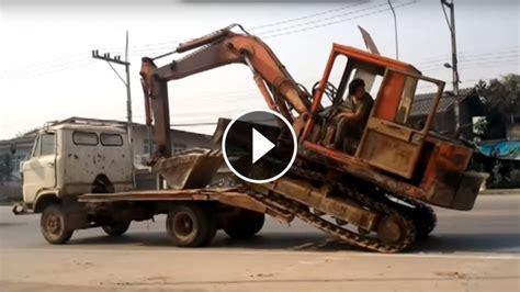 load  big excavator   small truck   boss
