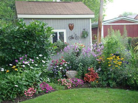flower garden plans flower bed in front of garden shed inspiration for sunny corner gardening pinterest