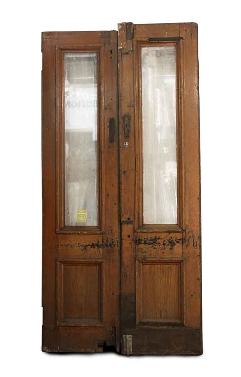 Double Oak Entry Doors With Single Panel Of Glass At Top