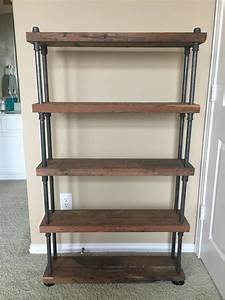 Custom Reclaimed Wood Shelving with Industrial Black Steel