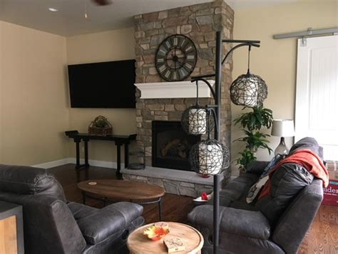 Decorating Ideas Next To Fireplace by How To Decorate Beneath Large Tv Next To Fireplace