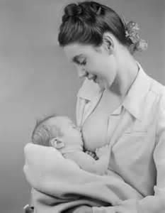 Black Mother Breastfeeding White Baby