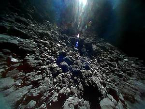 Photos from Japanese space rovers show asteroid is ...