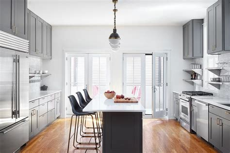 Charcoal Gray Island Cabinets With Small Hicks Pendants