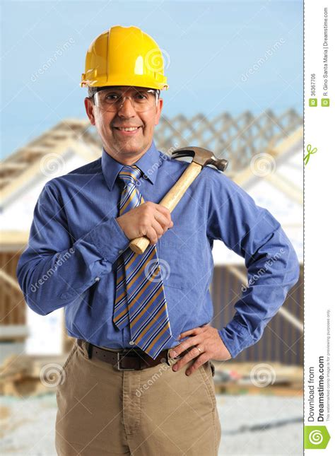 house blueprints free construction foreman smiling royalty free stock image
