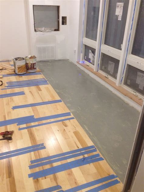 glue solid hardwood flooring gluing down prefinished solid hardwood floors directly over a concrete