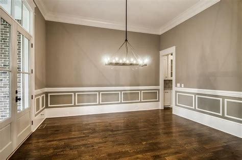 amazing dining room features walls painted gray accented
