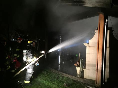 firefighters douse blaze  damaged hot tub patio