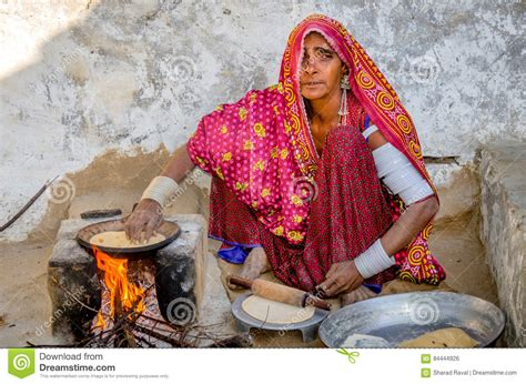 woman cooking food  wood fire editorial photo image