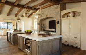 stainless steel topped kitchen islands mediterranean kitchen with rustic wood ceiling beams