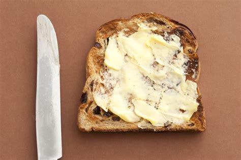 slice  bread  spreading butter  stock image
