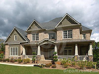 Luxury Model Home Exterior Stormy Weather Stock Photos