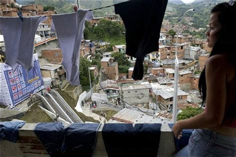 outdoor escalator opens in medellin slum in colombia ritemail