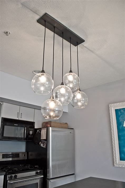 hanging pendant lights kitchen island if you think back to our kitchen tour you may remember the pendant light we had hanging above