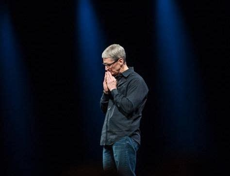 apple ceo tim cook takes the witness table at a