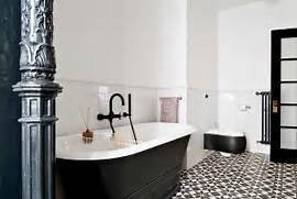 Black And White Bathroom With Cement Tile Flooring Design FJ Of Mismatched Black And White Floor Tiles In The Bathroom Decoist Black And White Bathroom Black And White Bathroom Design Black And Chris 39 Black And White Bathroom Remodel Amazing Attention To Detail