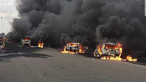 lagos nigeria explosion tanker oil cars fire explodes ibadan cnn fuel bridge otedola burn accident sets dead traffic june laden