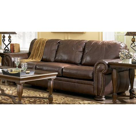 bernie and phyls sectional sofas ashley furniture leather sofas palmer walnut leather